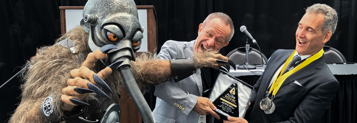 Terl grabbing the Audie Award for Battlefield Earth