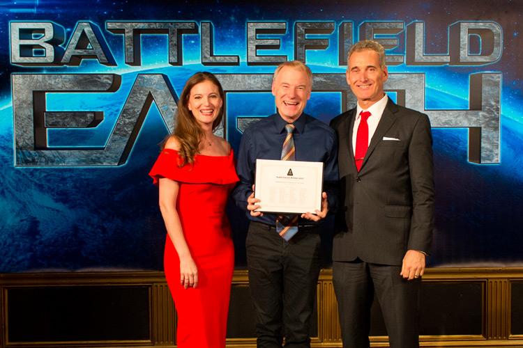 Emily Goodwin and John Goodwin present award to Jim Meskimen