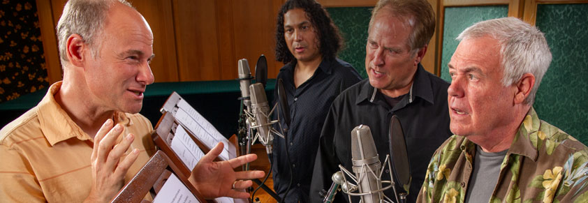 Jim Meskimen, as director, working with Phil Proctor, R.F. Daley, and Gino Montesinos in recording session of Battlefield Earth